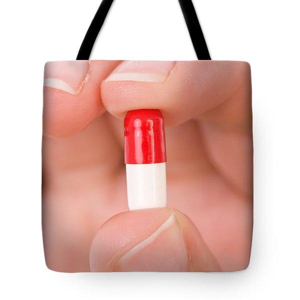 Hand Holding A Pill Tote Bag by Jose Elias - Sofia Pereira