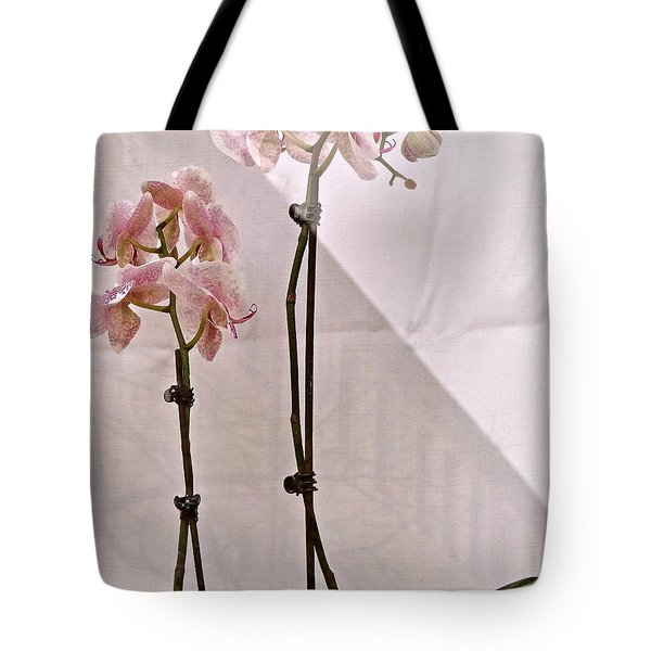 Tote Bag featuring the photograph  Orchids In The Window by Ira Shander