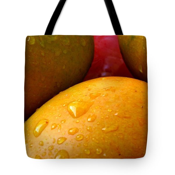 Tote Bag featuring the photograph  Tres Mangoes by Greg Allore