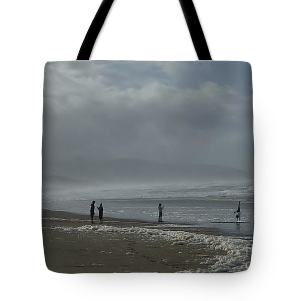 Tote Bag featuring the photograph  Wave Handstand  by Susan Garren