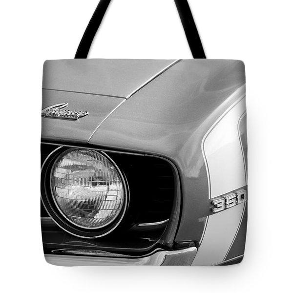 1969 Chevrolet Camaro Ss Headlight Emblems Tote Bag by Jill Reger
