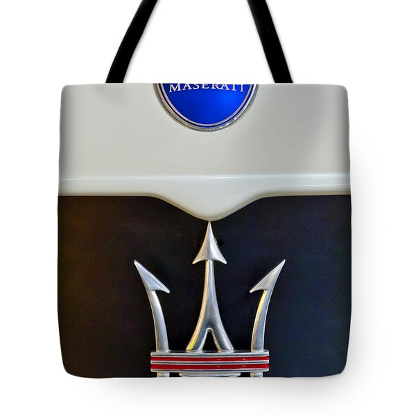 Tote Bag featuring the photograph 2005 Maserati Mc12 Hood Emblem by Jill Reger