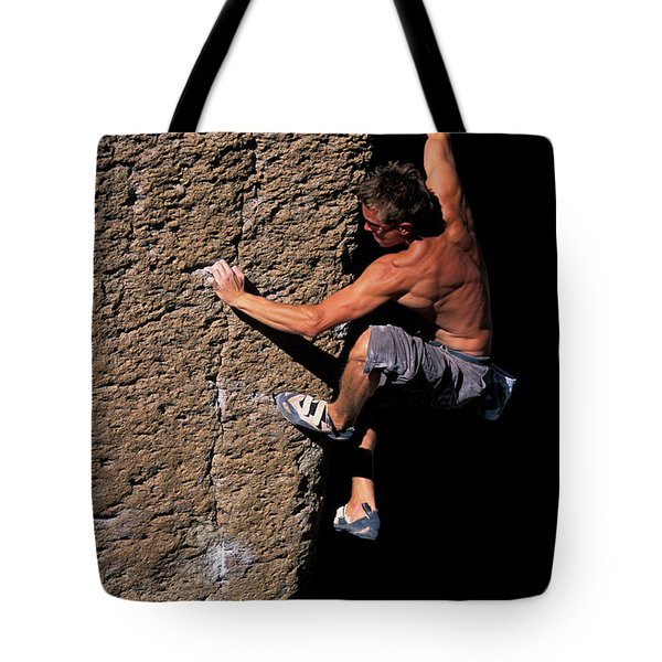 A Male Rock Climber Bouldering Tote Bag