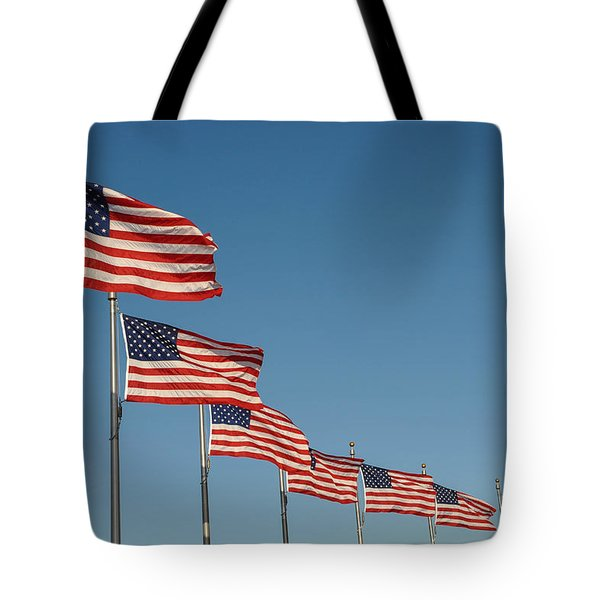 American Flag Waving In The Wind Tote Bag by Brandon Bourdages