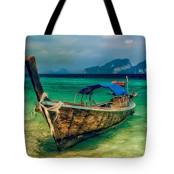 Tote Bag featuring the photograph Asian Longboat by Adrian Evans