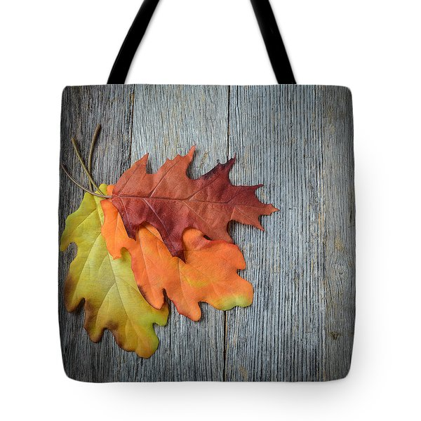 Autumn Leaves On Rustic Wooden Background Tote Bag