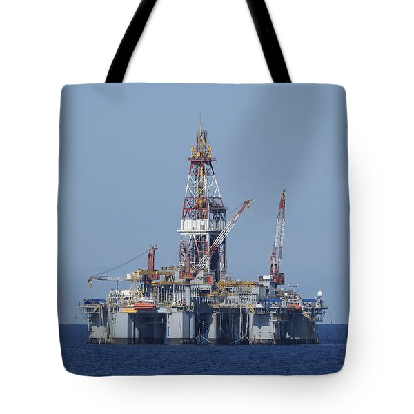 Tote Bag featuring the photograph Blue Water Oil Rig by Bradford Martin