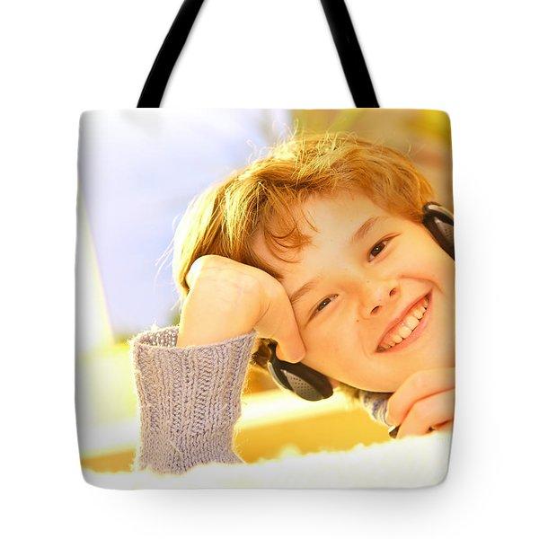 Boy Listen To Music Tote Bag by Michal Bednarek