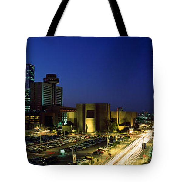Buildings In A City Lit Up At Night Tote Bag