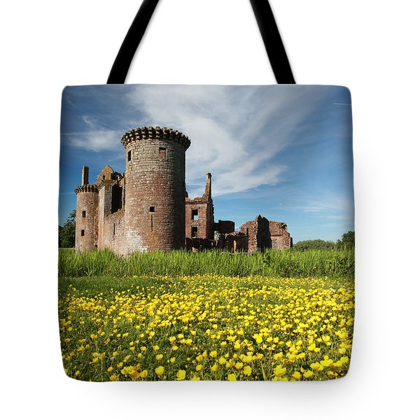 Tote Bag featuring the photograph Caerlaverock Castle by Maria Gaellman