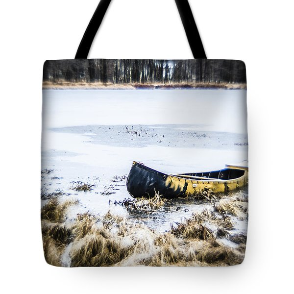 Canoe At The Frozen Lake Tote Bag