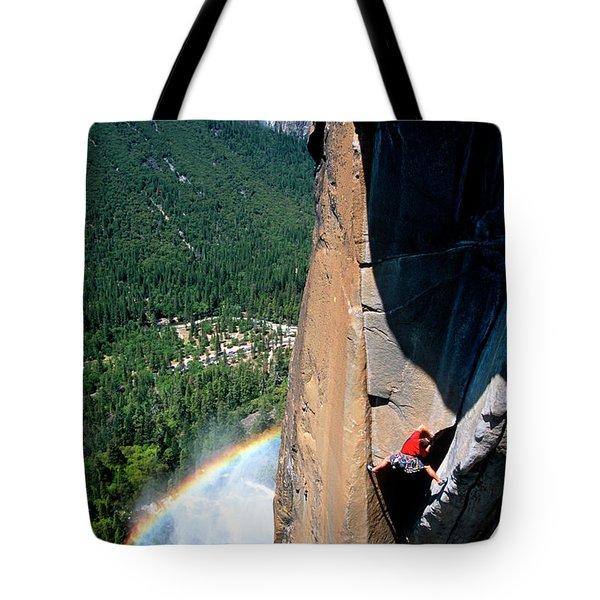 Climber Ascends A Steep Cliff Tote Bag