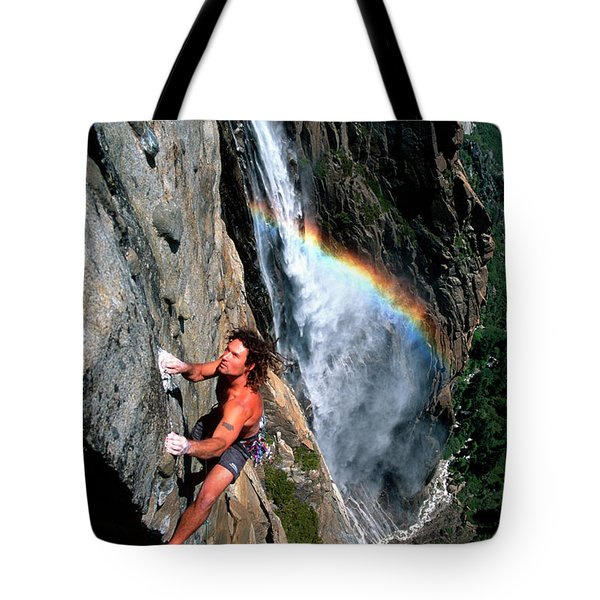 Climbers Ascend A Steep Cliff Tote Bag