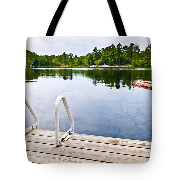 Dock On Calm Lake In Cottage Country Tote Bag