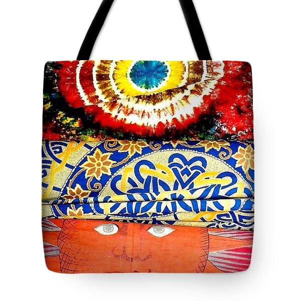 Tote Bag featuring the photograph Eye On Fabrics by Michael Hoard