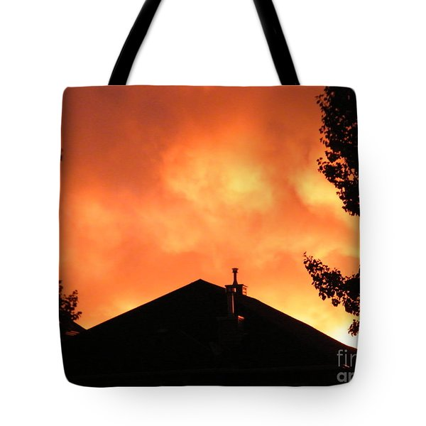 Tote Bag featuring the photograph Fire In The Sky by Ann E Robson
