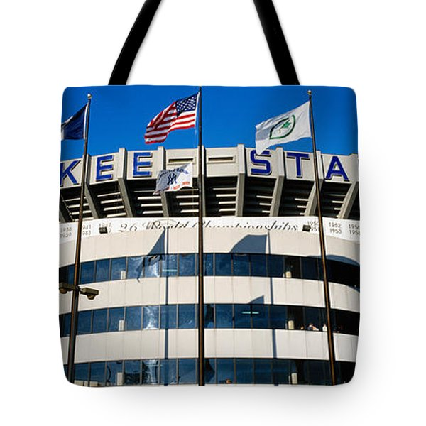 Flags In Front Of A Stadium, Yankee Tote Bag