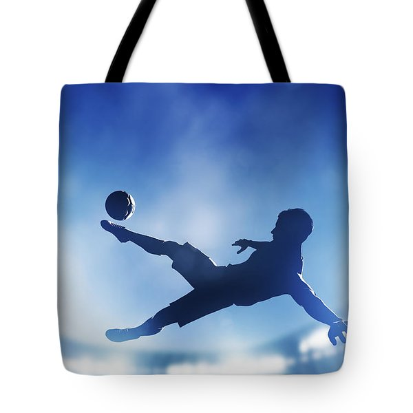 Football Soccer Match A Player Shooting On Goal Tote Bag by Michal Bednarek