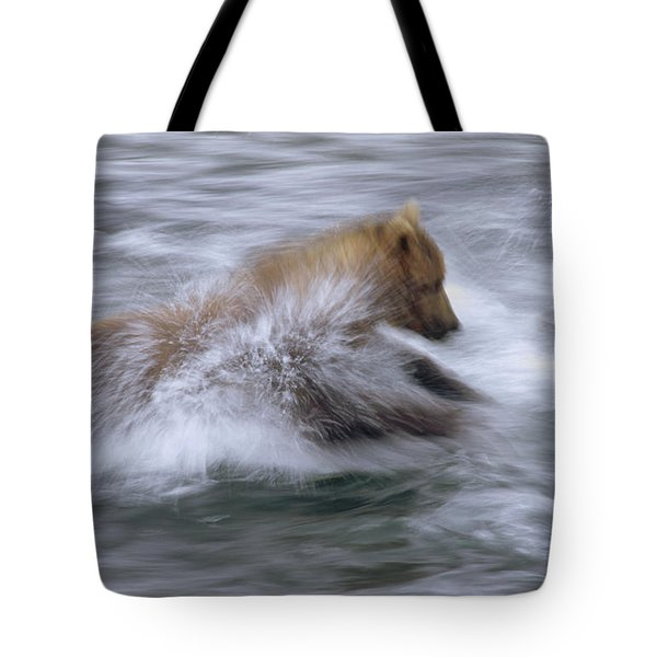 Grizzly Bear Chasing Fish Tote Bag by Matthias Breiter