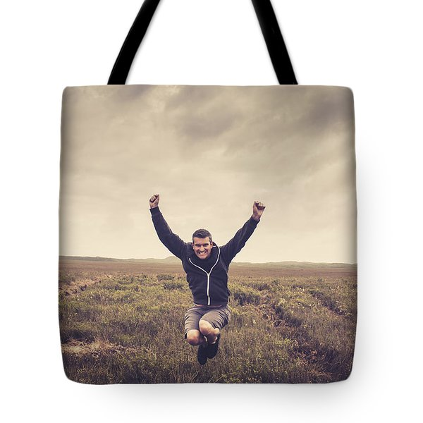 Holiday Man Jumping On Rural Australia Landscape Tote Bag