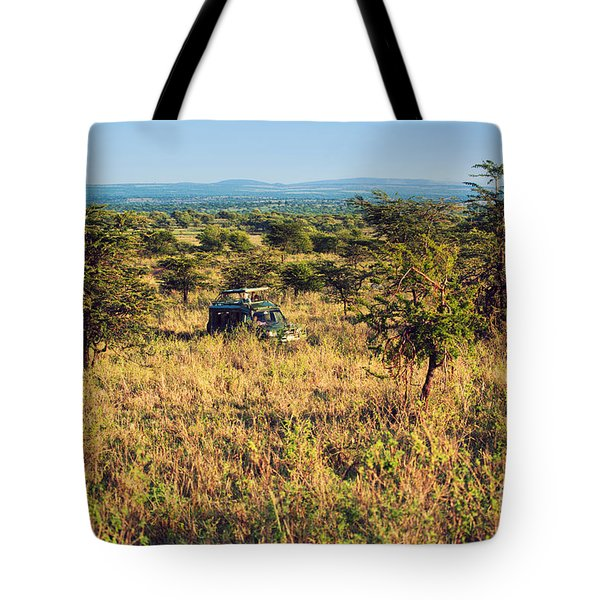 Jeep With Tourists On Safari In Serengeti. Tanzania. Africa. Tote Bag by Michal Bednarek
