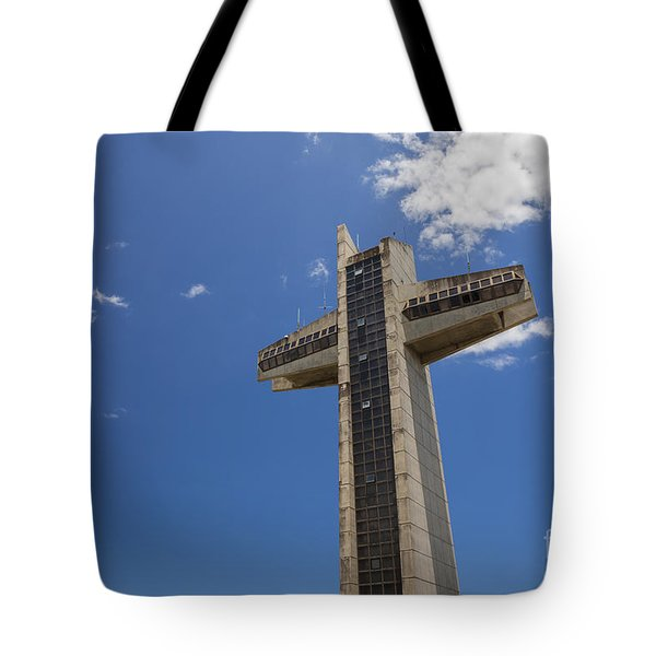 Tote Bag featuring the photograph La Cruz Del Vigia Against Blue Sky In Ponce Puerto Rico by Bryan Mullennix