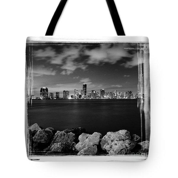 Miami Skyline At Night Tote Bag by Carsten Reisinger