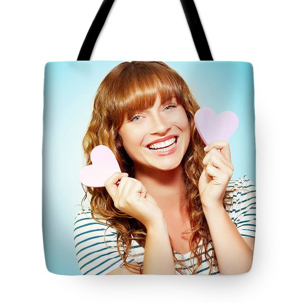 Mischievous Valentine Girl Holding Two Love Hearts Tote Bag