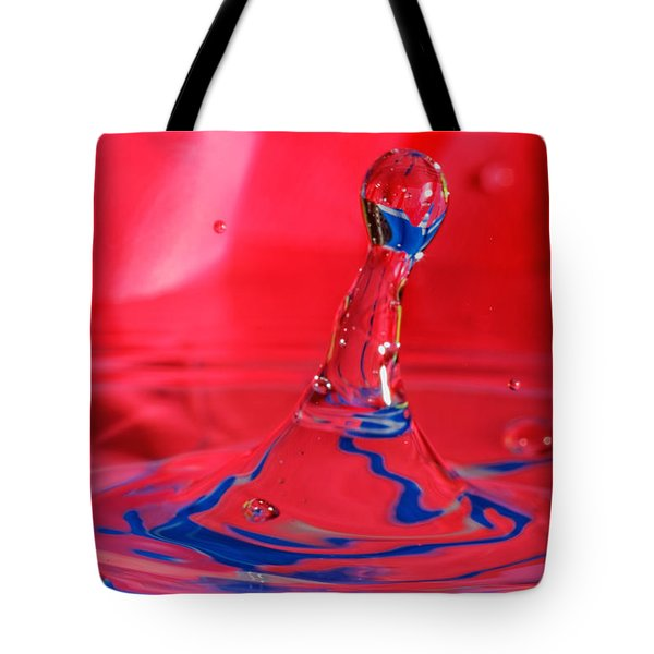 Tote Bag featuring the photograph Rainbow Drop by Peter Lakomy