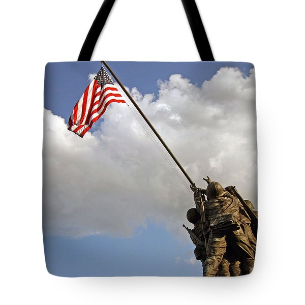 Tote Bag featuring the photograph Raising The American Flag by Cora Wandel