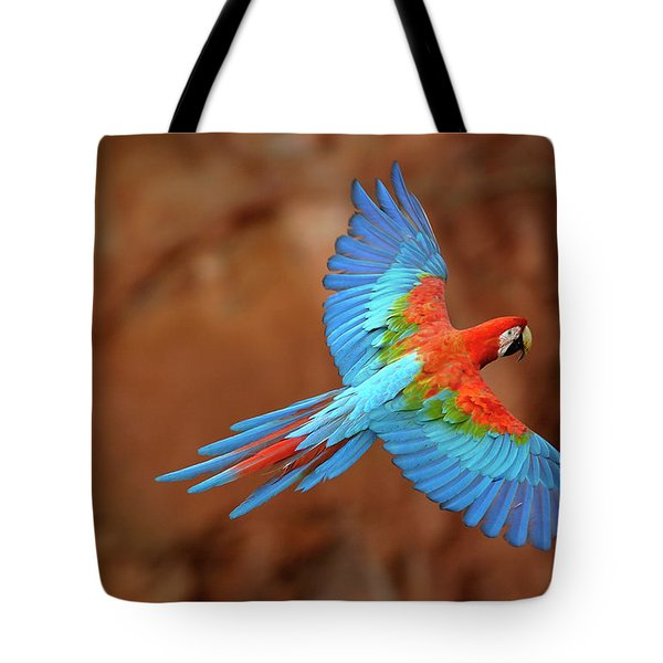 Red And Green Macaw Flying Tote Bag