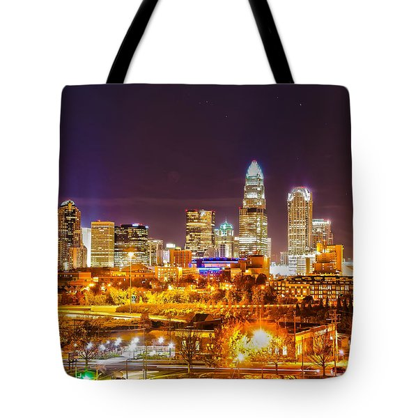 Tote Bag featuring the photograph Skyline Of Uptown Charlotte North Carolina At Night by Alex Grichenko