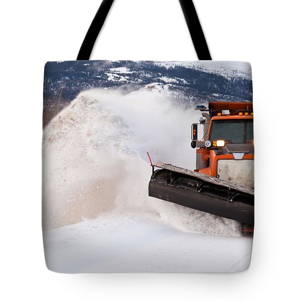 Snow Plough Clearing Road In Winter Storm Blizzard Tote Bag by Stephan Pietzko