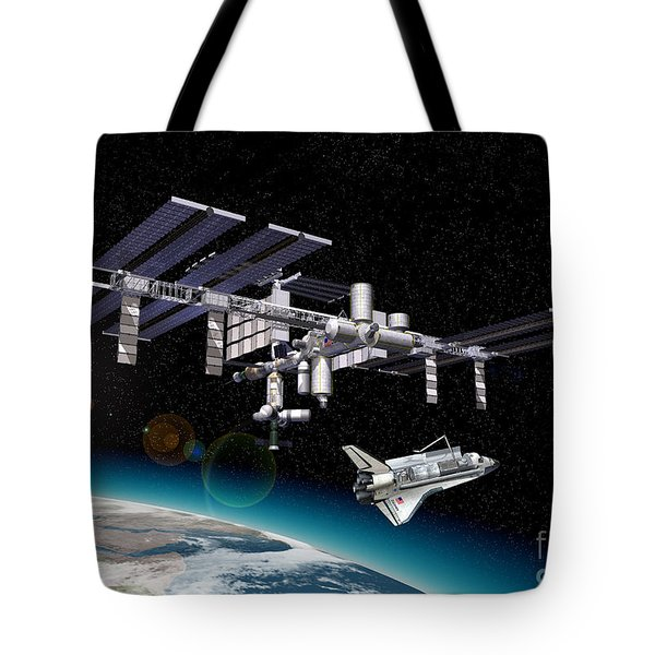 Space Station In Orbit Around Earth Tote Bag by Leonello Calvetti