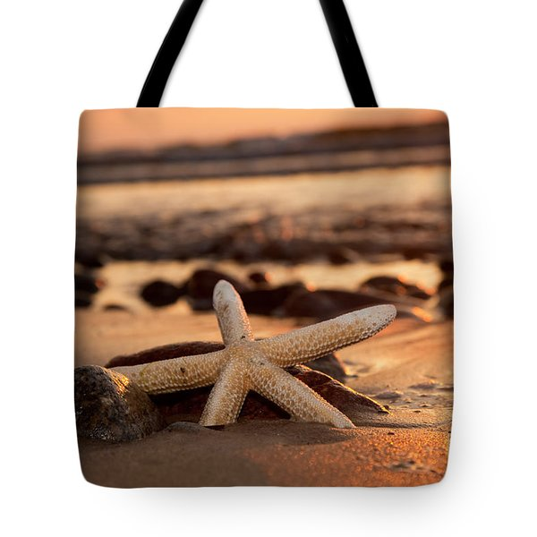 Starfish On The Beach At Sunset Tote Bag by Michal Bednarek