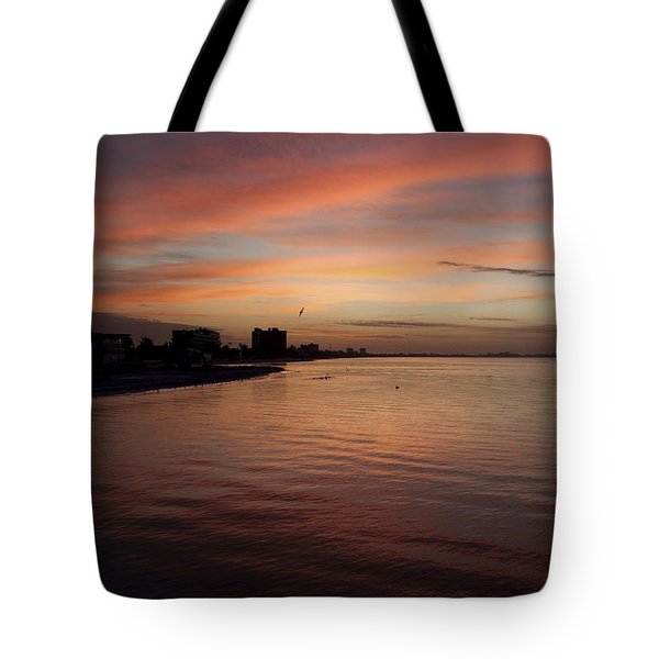 Tote Bag featuring the photograph Sunrise Over Fort Myers Beach Photo by Meg Rousher