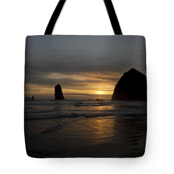 Sunset Over Haystack Rock In Cannon Beach Tote Bag by David Gn