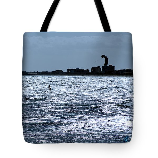 Tote Bag featuring the photograph Surfing In Blue by Chris Thomas
