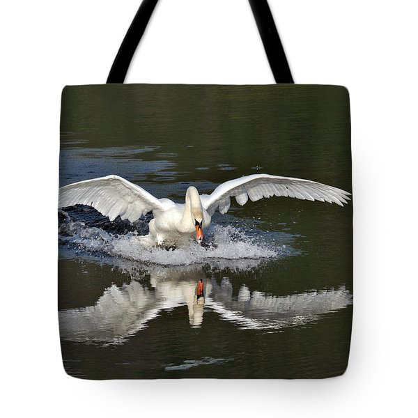 Tote Bag featuring the photograph Swan Landing by Simona Ghidini