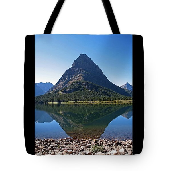 Tote Bag featuring the photograph Swiftcurrent  Lake Many Glacier by Joseph J Stevens