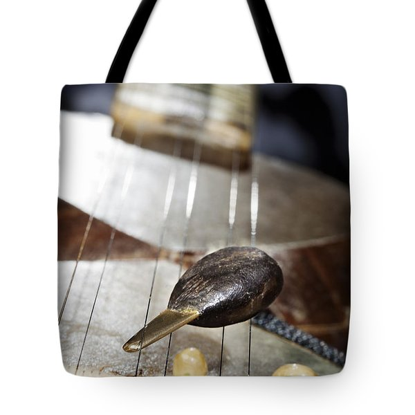Tar Plectrum And Bridge Tote Bag by Eldad Carin