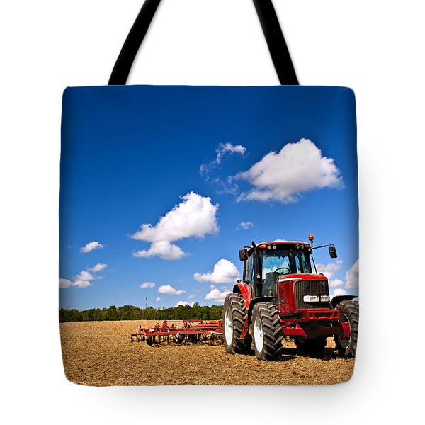 Tractor In Plowed Field Tote Bag by Elena Elisseeva