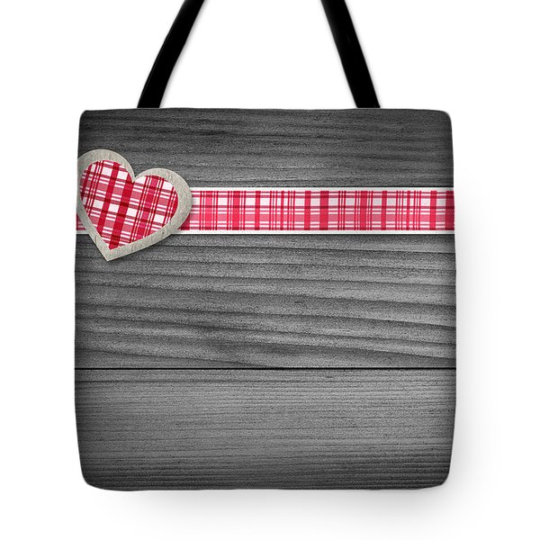 Two Hearts Laying On Wood  Tote Bag by Aged Pixel