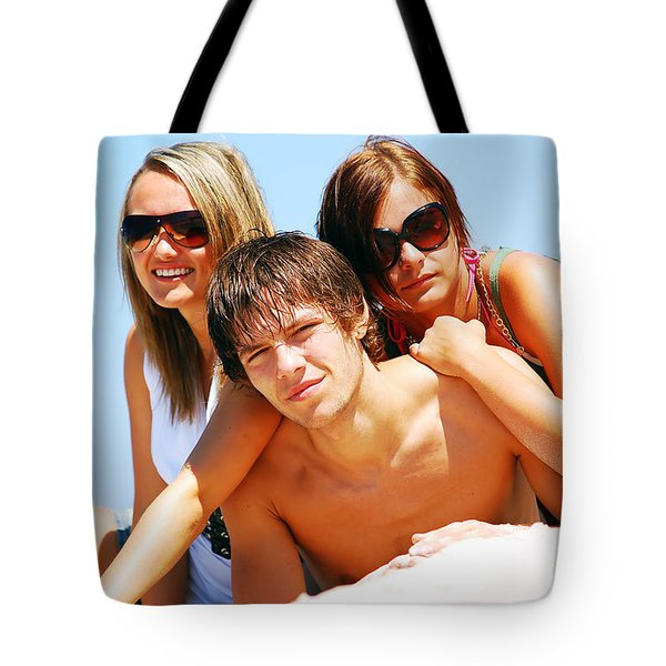 Young Friends On The Summer Beach Tote Bag by Michal Bednarek