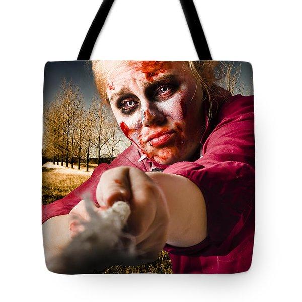 Zombie Pulling Tug Of War Rope. Determined Spirit Tote Bag