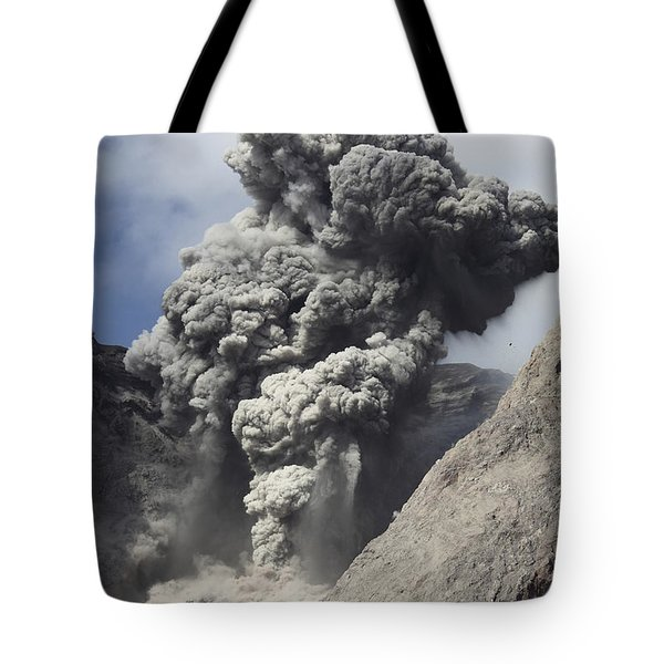 Ash Cloud Rises From Crater Of Batu Tote Bag by Richard Roscoe