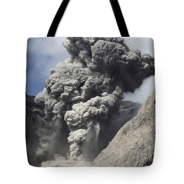 Ash Cloud Rises From Crater Of Batu Tote Bag by Richard Roscoe