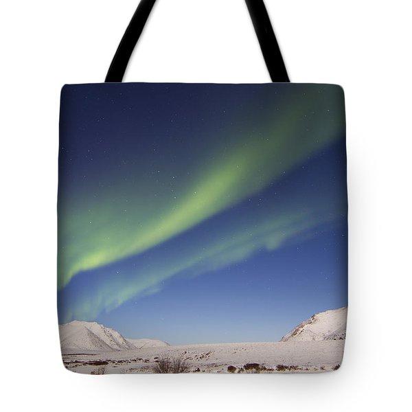 Aurora Borealis With Moonlight Tote Bag by Joseph Bradley