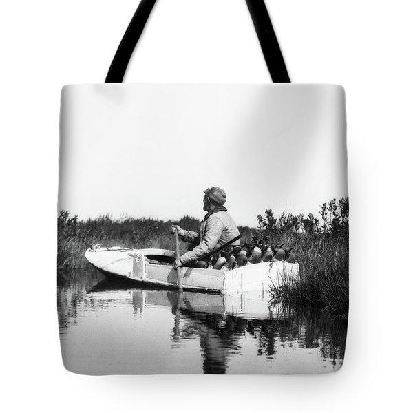 1920s Man Hunter Paddling Small Boat Tote Bag