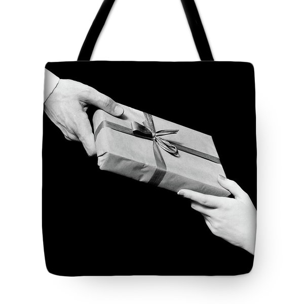1930s Man And Woman Hands Exchanging Tote Bag